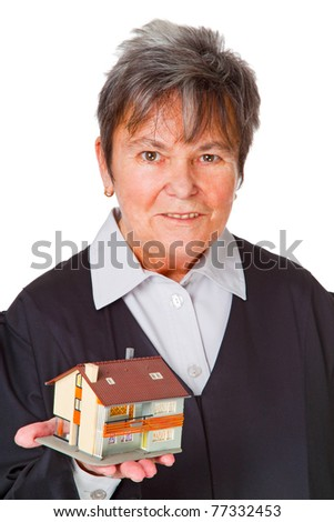 Female lawyer with model house - isolated on white background