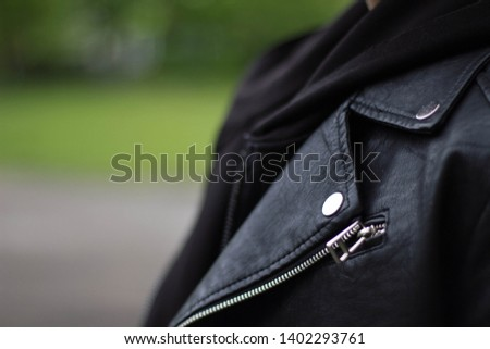 Female leather jacket, Detail close-up of suit jacket lapel button hole fabric. #1402293761