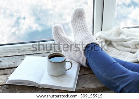 female legs and hot drink on...
