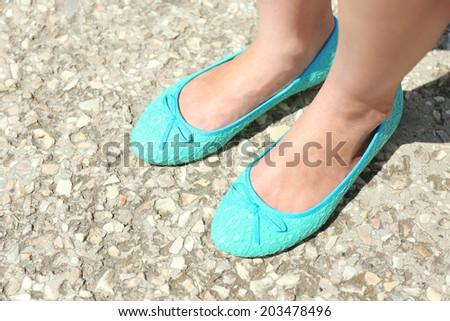 Female legs in beautiful shoes outside