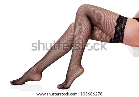 Female legs in black pantyhose, isolated on white - stock photo
