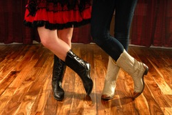 Female Legs in Cowboy Boots in a Line Dance Step on hardwood floor