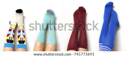 female legs in funny long socks on a white background #745773691