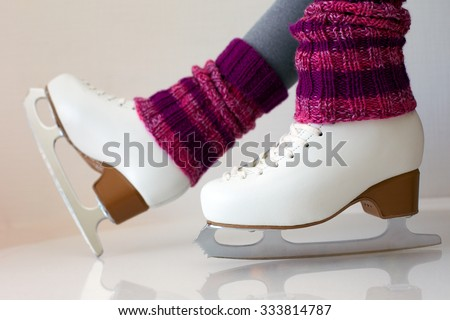 Female legs in gaiters and ice skates. Winter fun #333814787