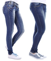 Female legs in jeans isolated on white