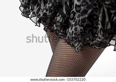 female legs with fishnet stockings and mini skirt