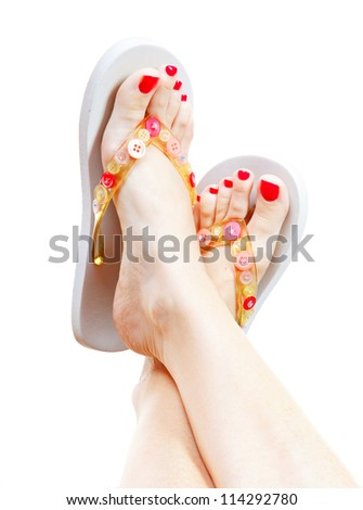 Female legs with flip-flops, isolated on white background.