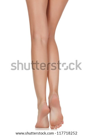 Female legs with pink heels isolated on white background