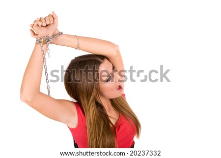 Female locked by metal chain with pain countenance.