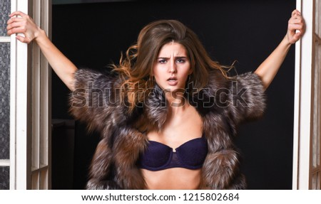 Female lover enter bedroom doors. Fashion lady confident and seductive. Woman seductive appearance. Confident in her magnetism. Woman seductive wear luxury fur and lingerie. Seduction art concept.