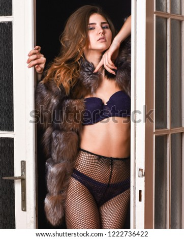 Female lover enter bedroom doors. Fashion lady confident and seductive. Woman seductive appearance. Confident in her magnetism. Seduction art concept. Woman seductive wear luxury fur and lingerie.