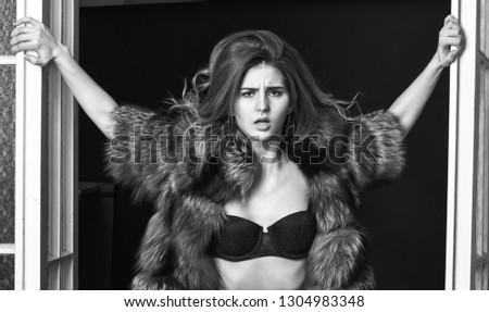 Female lover enter bedroom doors. Fashion lady confident and seductive. Woman seductive appearance. Confident in her magnetism. Woman seductive wear luxury fur and lingerie. Seduction art concept.
