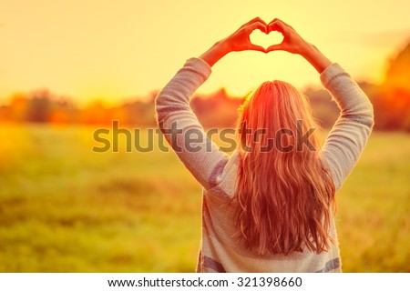 female making symbol for loving the season #321398660
