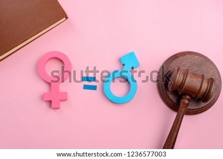 Female, male signs and gavel on pink background. Court rules for gender equality. Social and justice concept.