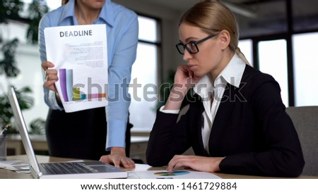 Female manager swearing employee for missed deadline, low income and poor work #1461729884