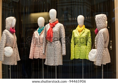 Female mannequins dressed in winter clothes are on display at the