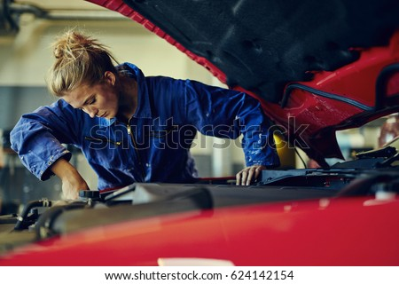 Female mechanic working on car #624142154