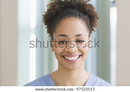 Female medical assistant wearing scrubs