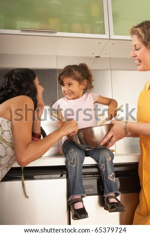 Female members of a family cooking together