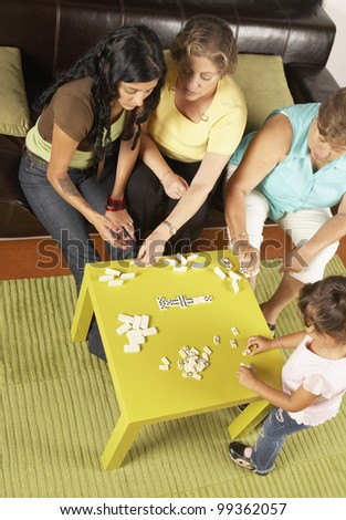 Female members of a family playing dominoes