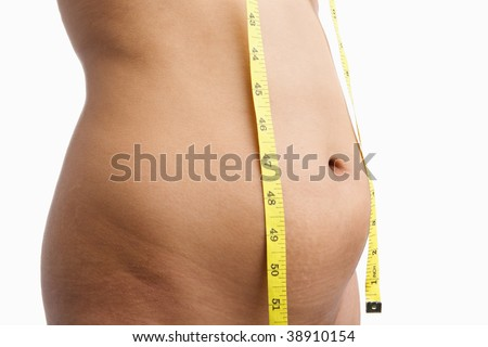 Female mid section with measuring tape for obesity issue
