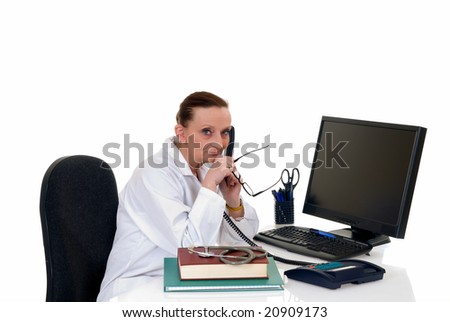 Female middle aged doctor making phone call with patient, white background,  studio shot.