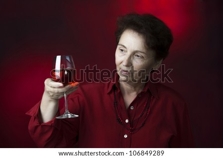 female model holding and looking rose  wine glass like wine control expert
