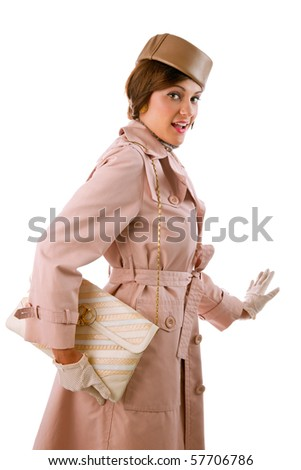 female model in vintage retro gabardine raincoat going off to shop