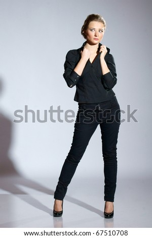 stock-photo-female-model-posing-in-black-clothes-in-studio-67510708