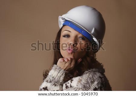 Female model wearing a white hard hat