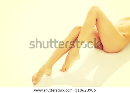 Female nude legs, buttock and slim belly.