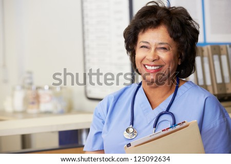 Female Nurse At Nurses Station