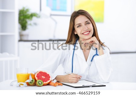 Shutterstock Female nutritionist with fruits working at her desk