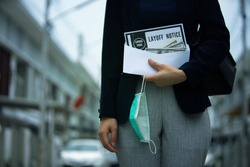 female office worker  holding Layoff notice after Covid-19(coronavirus) spread and Covid-19 lock down Company recession and jobs hit by pandemic
