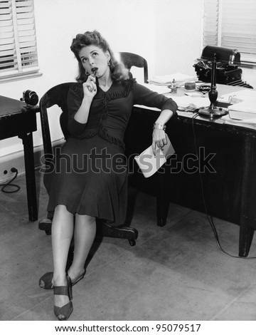 Female office worker in thought