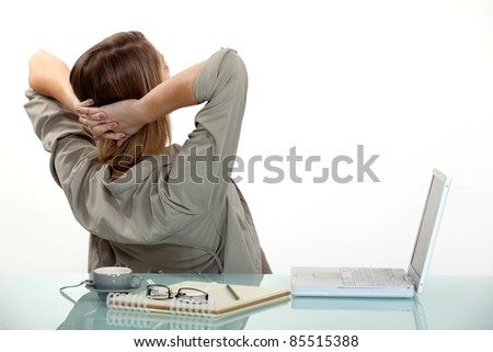 Female office worker relaxing at desk