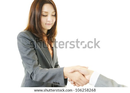 Female office worker who shakes hands