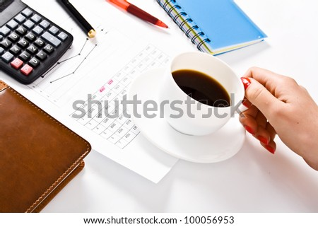 female officer holding white coffee cup during working time at office.
