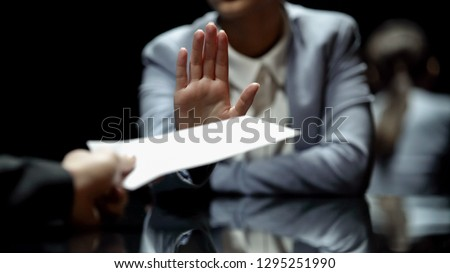 Female official refuses to take bribe, anti-corruption laws in action, close up Foto stock ©