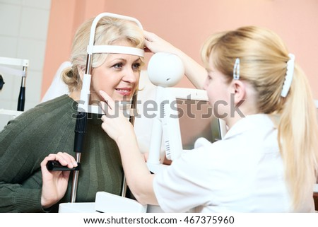 Female ophthalmologist or optometrist at work