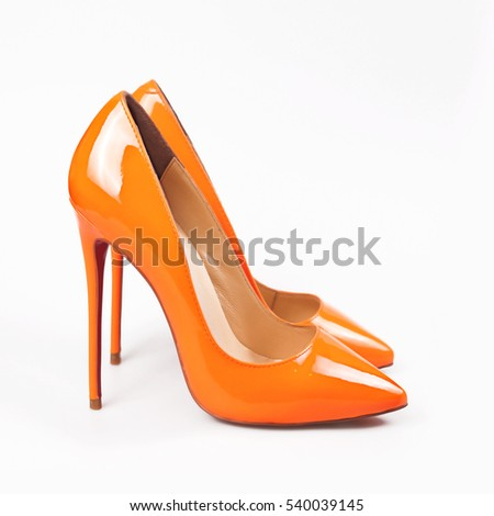Female orange shoes over white  #540039145