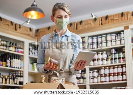 Female Owner Delicatessen With Digital Tablet Wearing Face Mask Preparing Online Grocery Order Photo stock ©