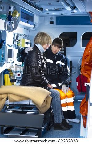 Female Paramedic Assisting Injured Woman - stock photo