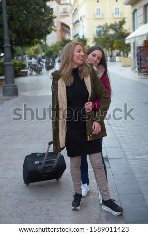 female partner say goodbye with affectionate hug