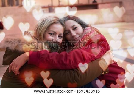 female partner with affectionate hug