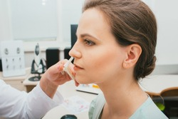 Female patient during nose check procedure, diagnosis and treatment of nasal disease. Sinusitis treatment