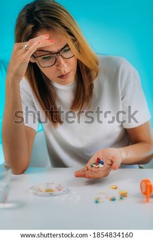 Female patient failing to follow medical advice, demonstrating prescribed medicine non-adherence behavior.  Stock photo ©