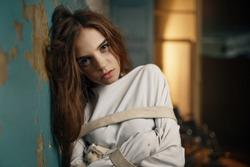 Female patient in strait jacket, mental hospital