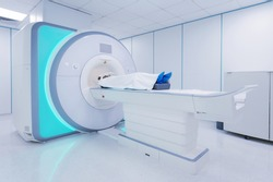 Female patient undergoing MRI - Magnetic resonance imaging in Hospital. Medical Equipment and Health Care.