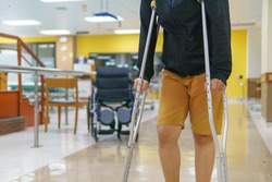 Female patients are training with a crutch in the hospital. medical and orthopedic concept. with copy space for text